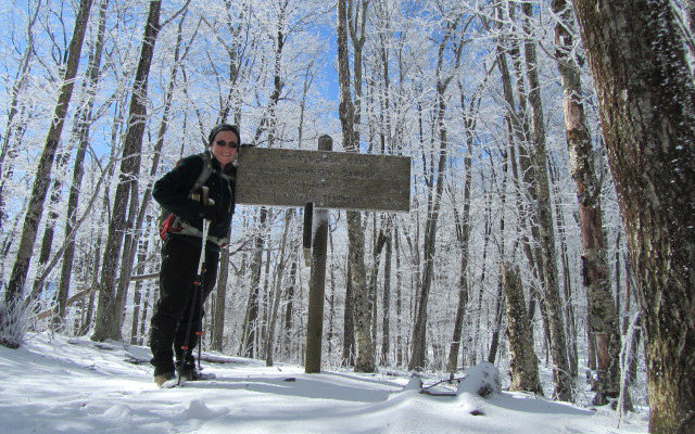 Sam McGroom with GSMNP trail sign