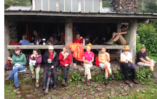 Hikers eat lunch at Icewater Spring Shelter along the AT