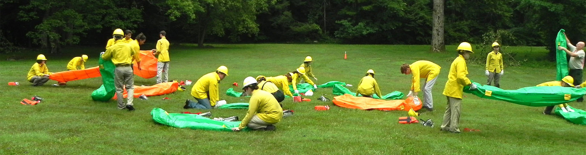 Interns rolling fire shelters