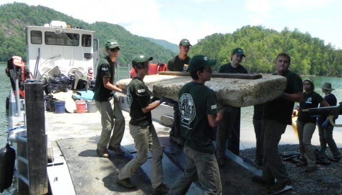 NC interns cleaning lake