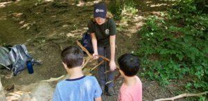 GSMNP intern with visitors at Laurel Falls Trailhead