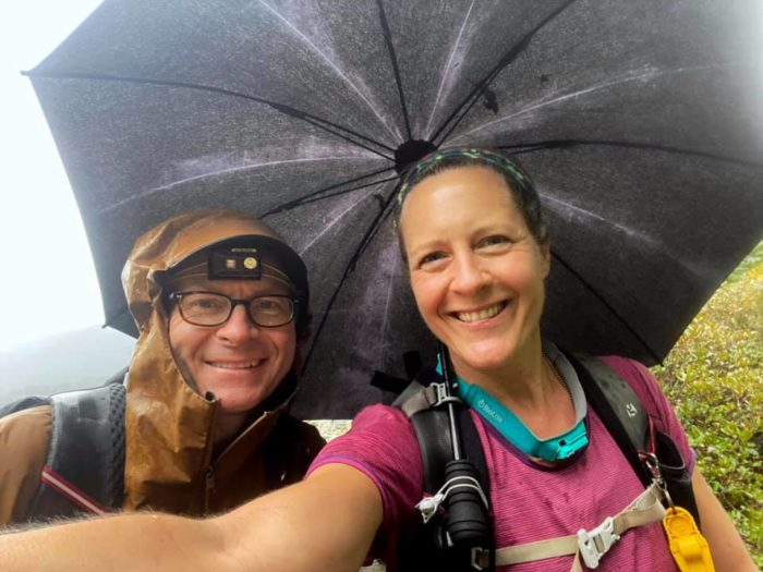 Chris Ford and Nancy East with hiking umbrella