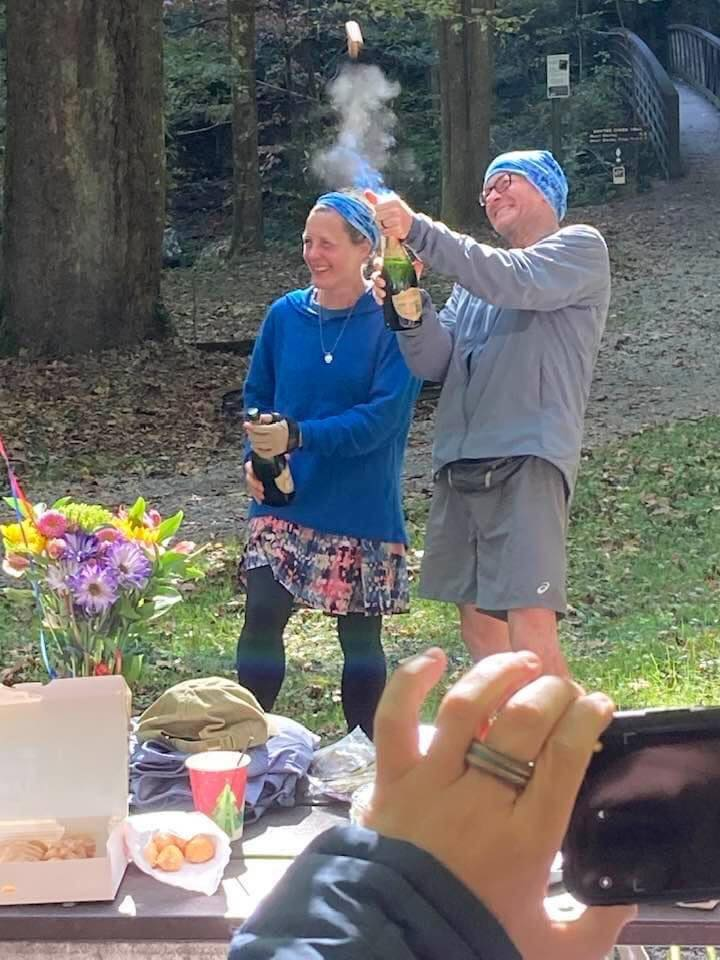 Nancy East and Chris Ford celebrate finishing Tour de Smokies