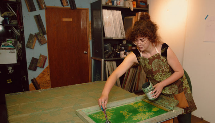 Dayna Walton creating fabric design