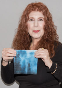 Phoenix and lens cloth with her photograph