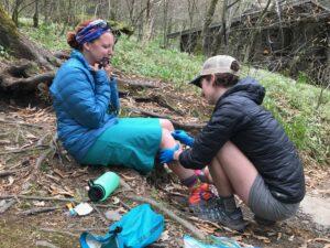 Ridgerunner provides first aid to an injured hiker