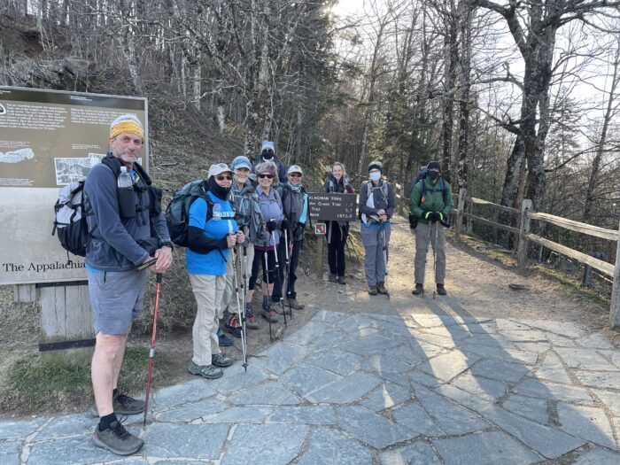 Smoky Mountains Hiking Club members carry mulch to Icewater Springs shelter