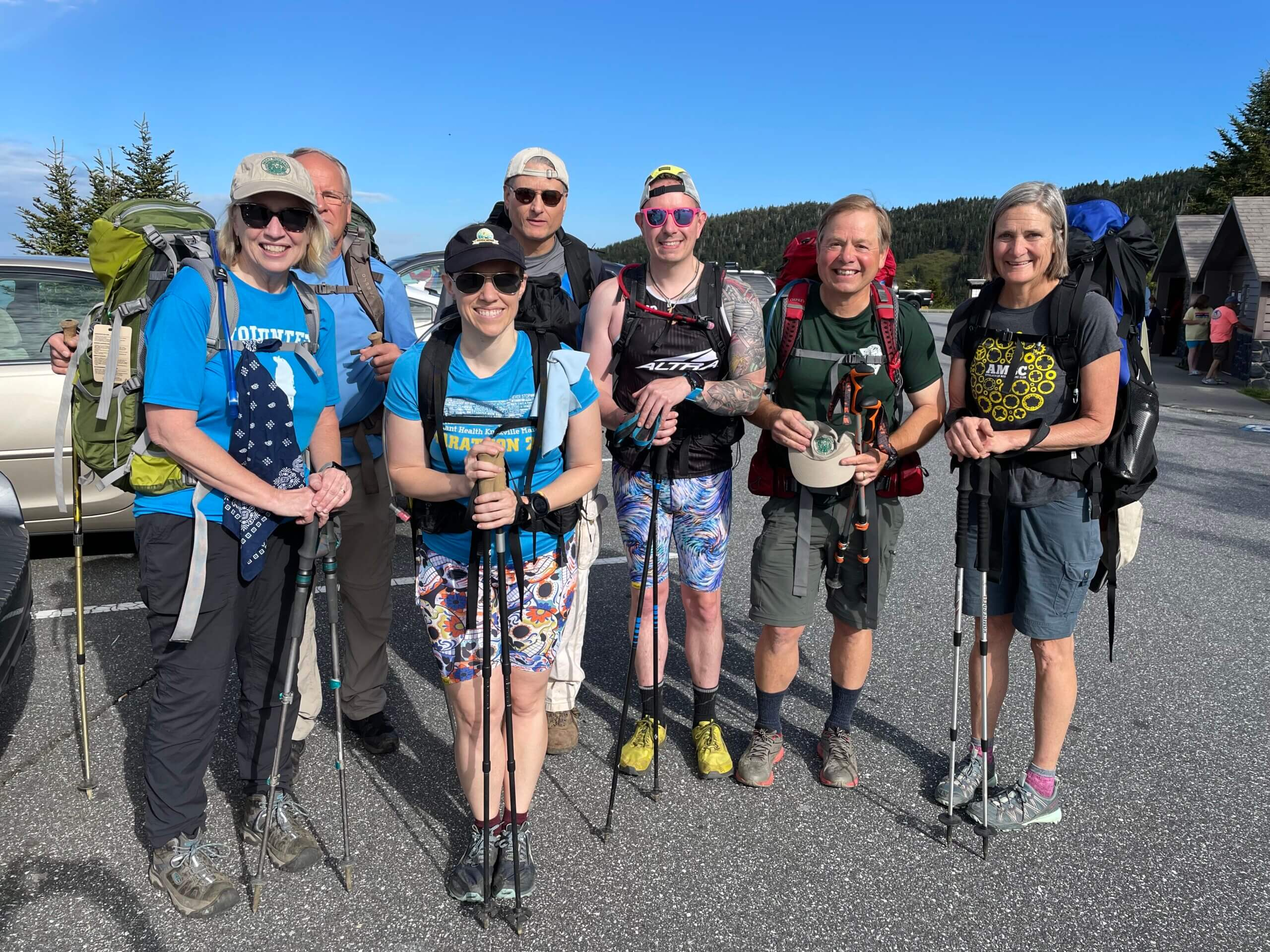 Smoky Mountains Hiking Club members carry mulch to Double Springs shelter