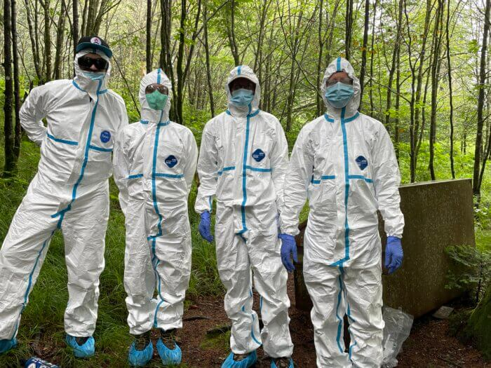 Smoky Mountains Hiking Club members in haz-mat suits