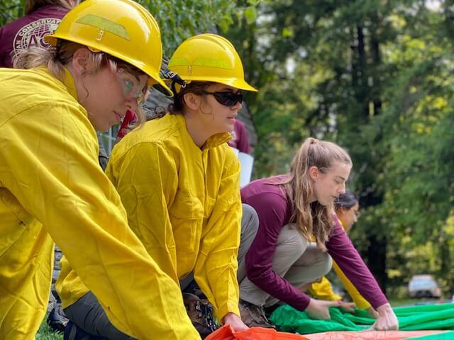 high school interns prepare fire shelters in GSMNP