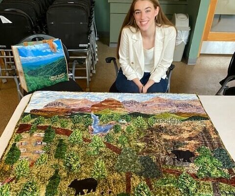 Grace Pepperman and her quilt